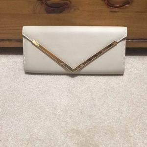 Beige evening purse from Aldo